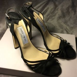 Jimmy Choo elegant and delicate high heels.